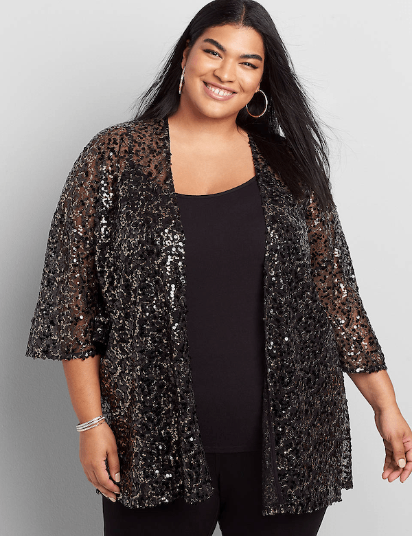 A model wearing a plus-size multi-colored sequin jacket.