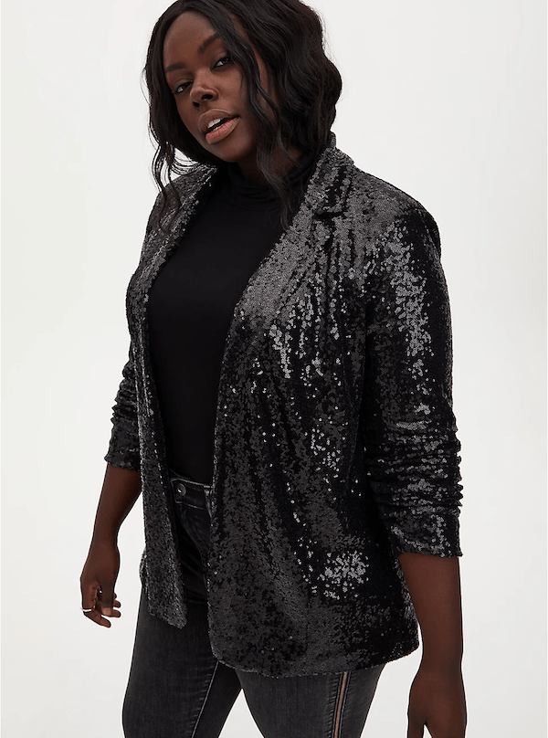 A model wearing a plus-size black sequin jacket.
