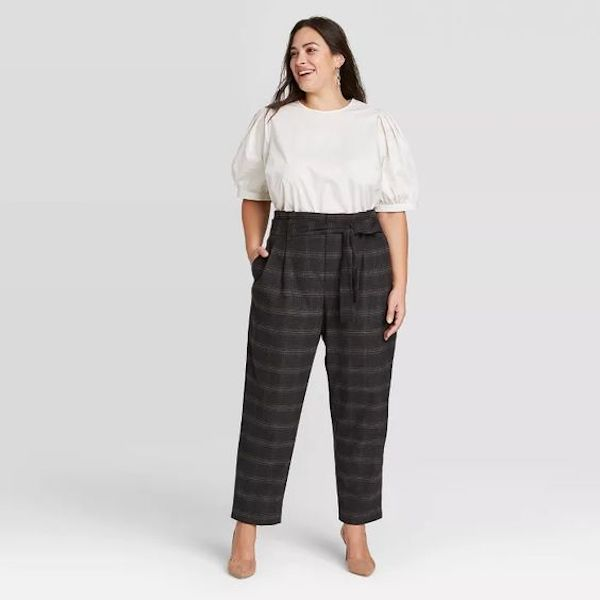 A plus-size model from Target wearing gray plaid pants.