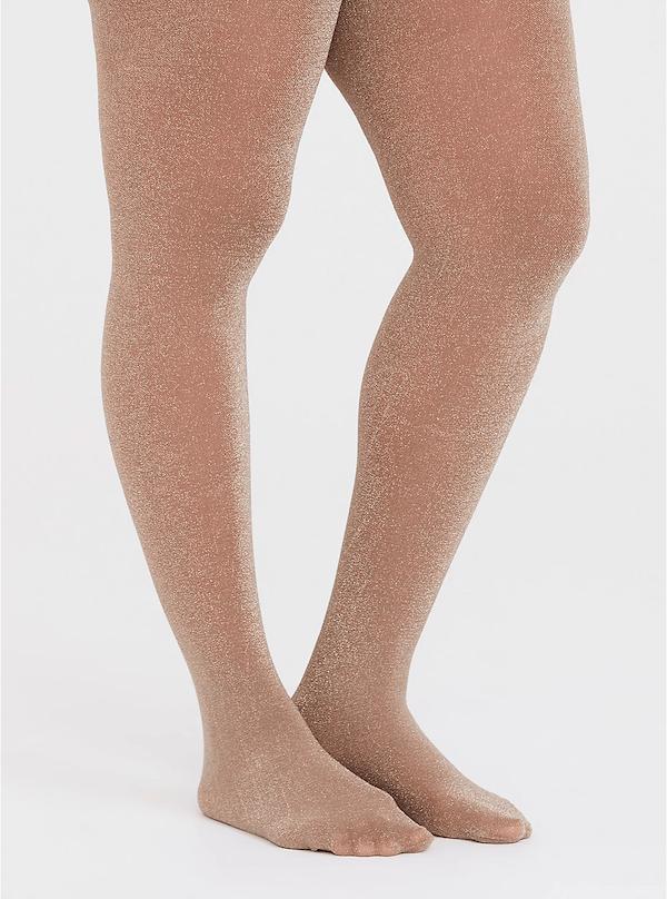 A plus-size model wearing beige tights.