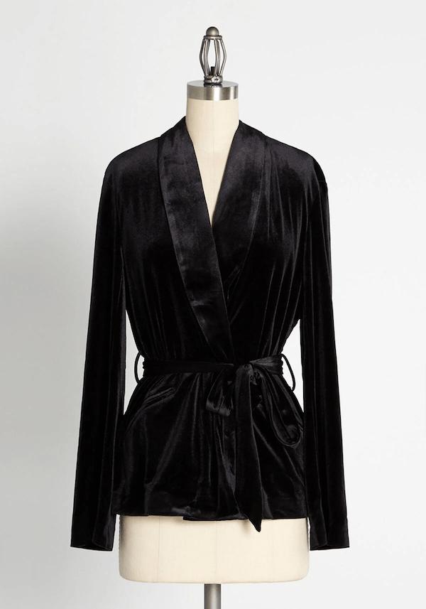 A black wrap velvet jacket.
