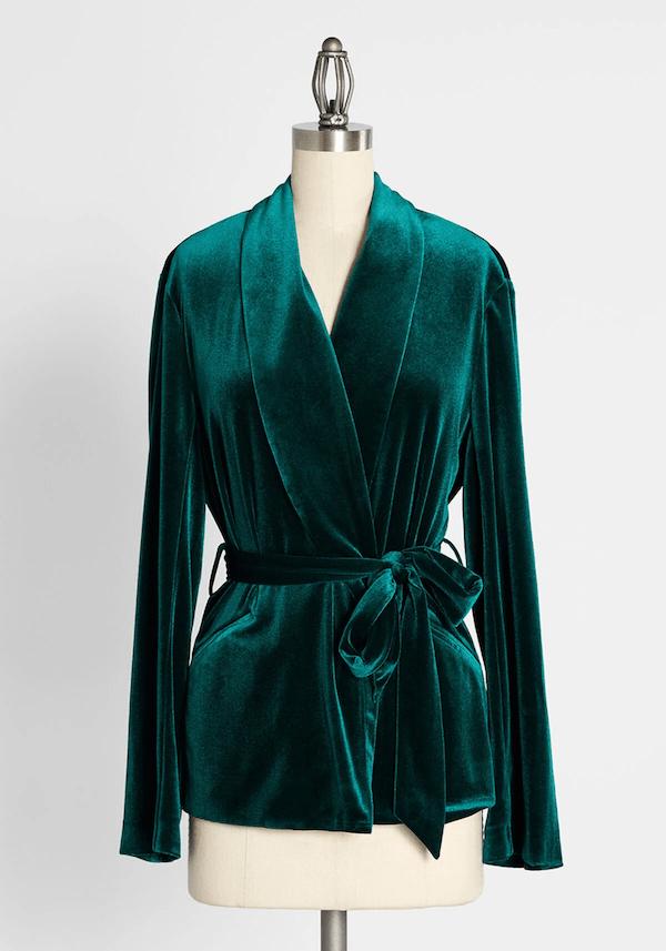 A green wrap velvet jacket.