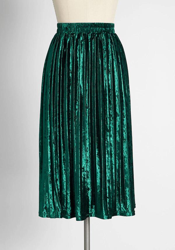 A green pleated velvet skirt.