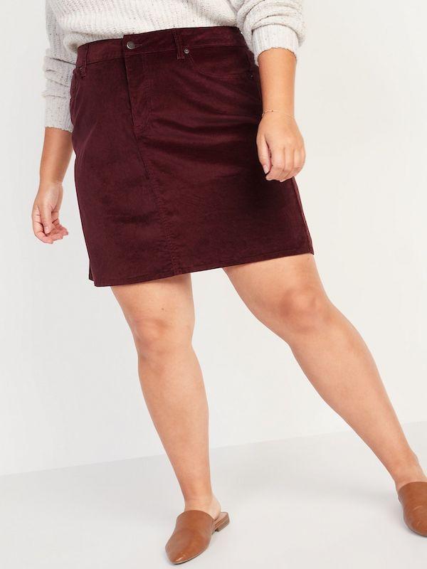 A plus-size model wearing a velvet mini skirt.