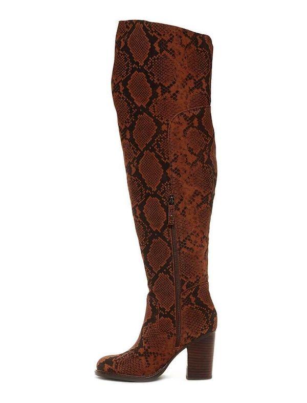 A pair of brown snake print wide-calf thigh-high boots.