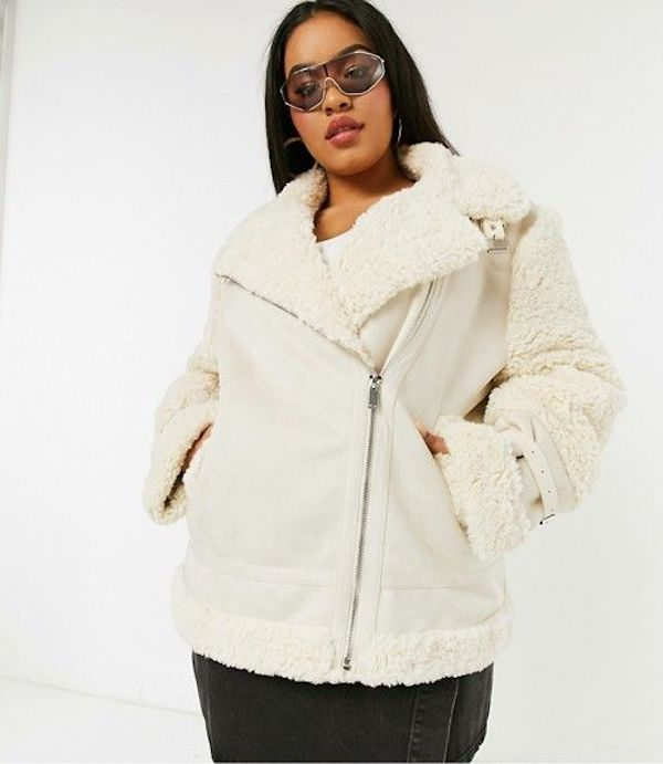 A model wearing a plus-size aviator jacket in white.