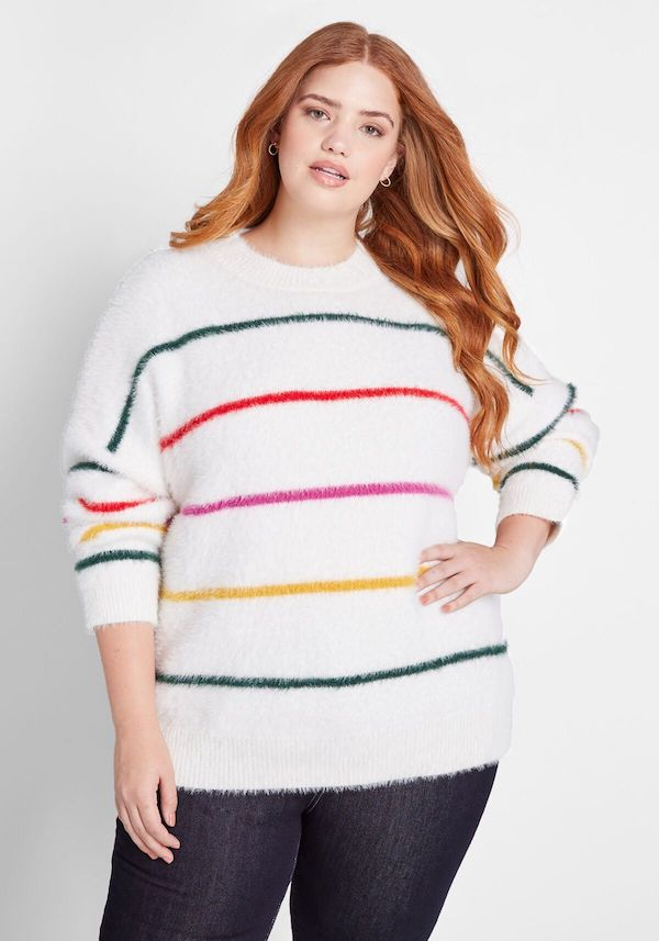 A model wearing a plus-size striped chenille sweater.