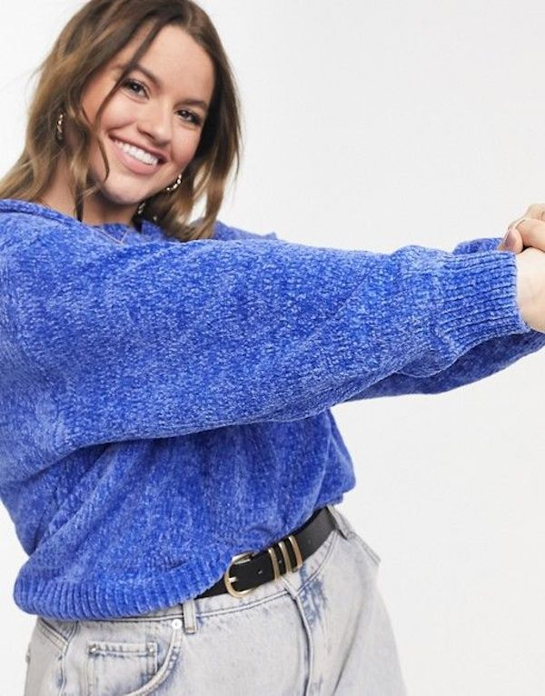 A model wearing a plus-size blue chenille sweater.