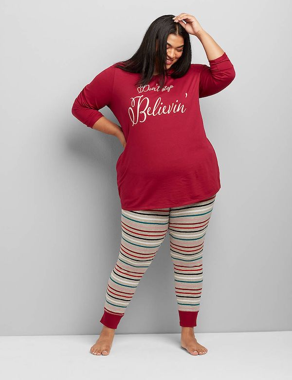 A model wearing plus-size red and striped Christmas pajamas.
