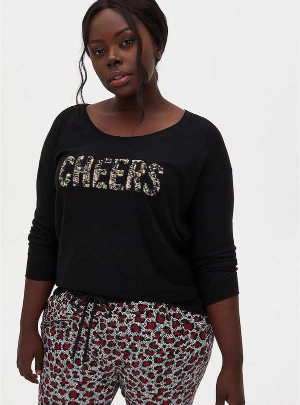 """A model wearing plus-size sweatshirt that says """"cheers."""""""