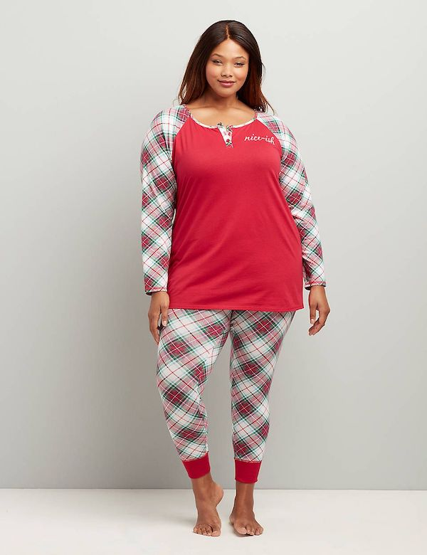 A model wearing plus-size red plaid Christmas pajamas.