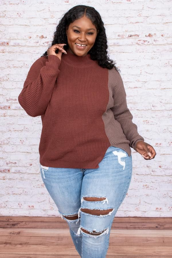 A model wearing a plus-size colorblock sweater in two different brown tones.