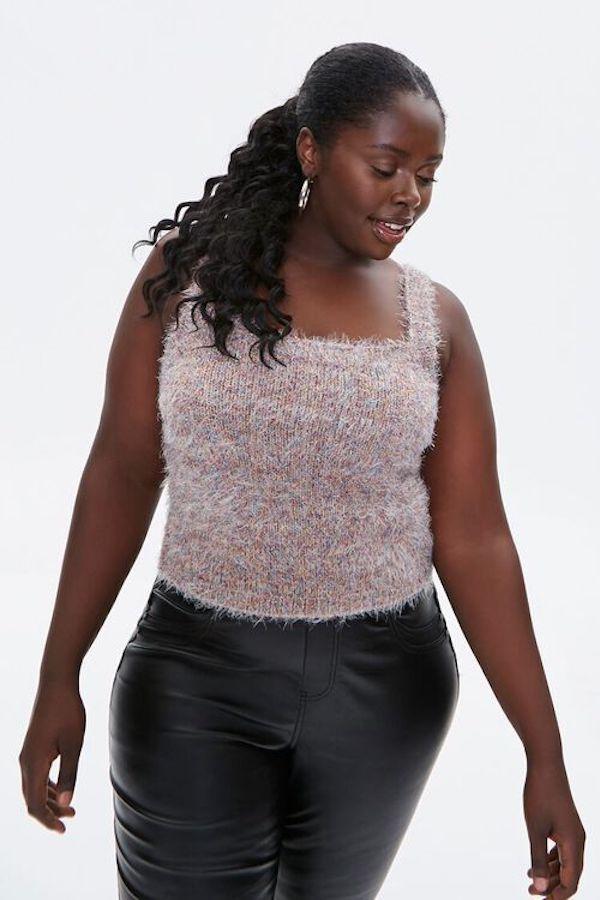 A model wearing a plus-size cropped sweater in fuzzy purple.