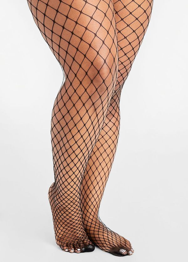 A model wearing a pair of black fishnet tights.