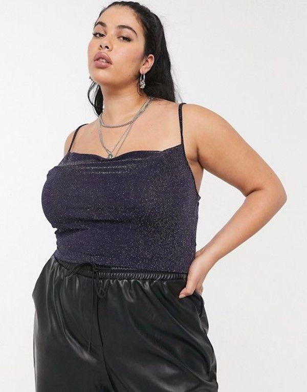 A model wearing a plus-size glitter tank top.