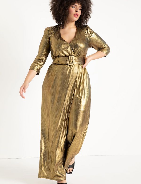 A model wearing a plus-size metallic gold jumpsuit.