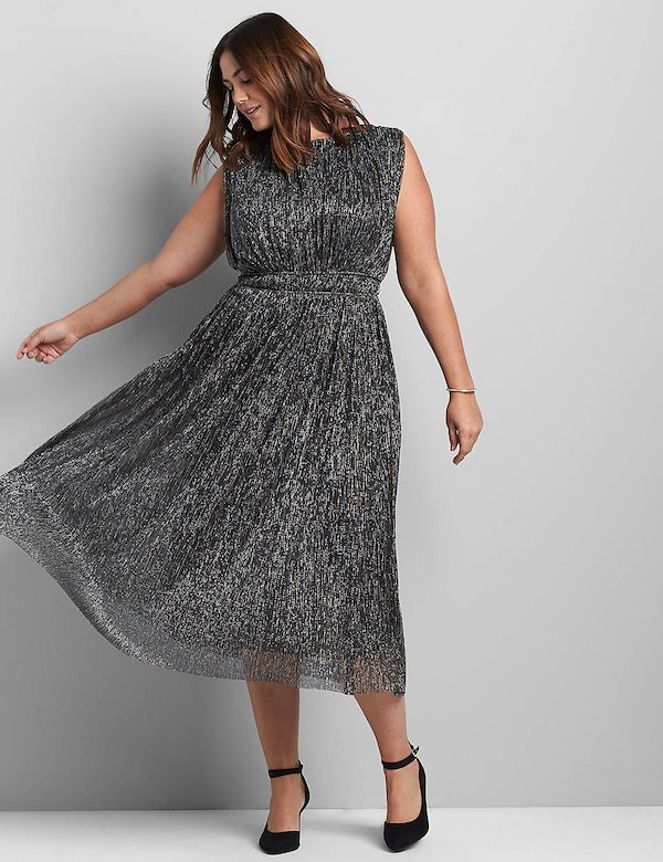 A model wearing a plus-size metallic silver dress.