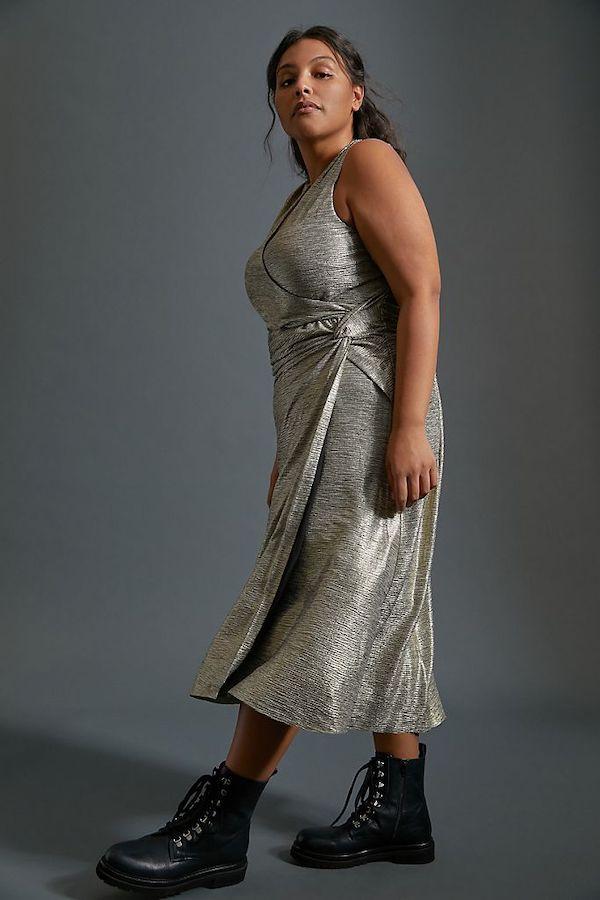 A model wearing a plus-size silver maxi dress.