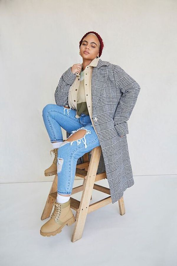A model wearing a plus-size plaid coat in gray.