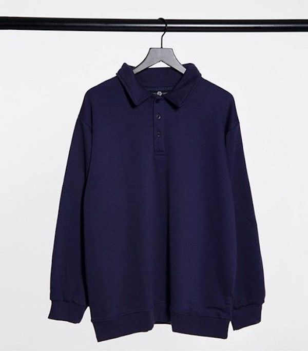 A plus-size polo shirt in navy.