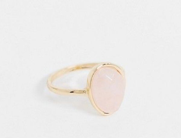 A plus-size gold and pink ring.