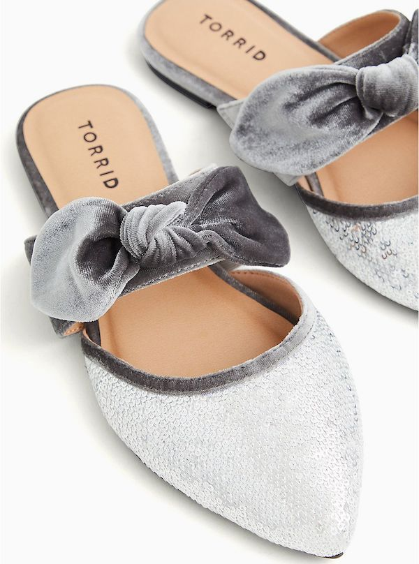 Sparkly silver wide-fit bow flats.