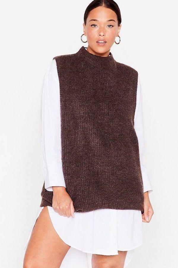 A model wearing a plus-size brown sweater vest.