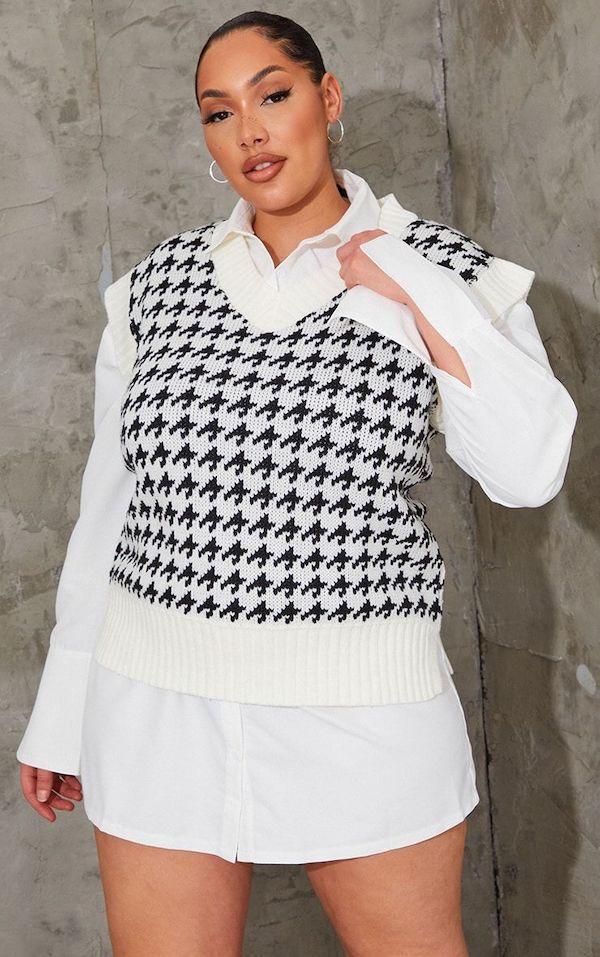 A model wearing a plus-size sweater vest.