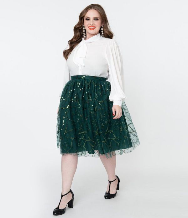 A model wearing a plus-size green tulle skirt.