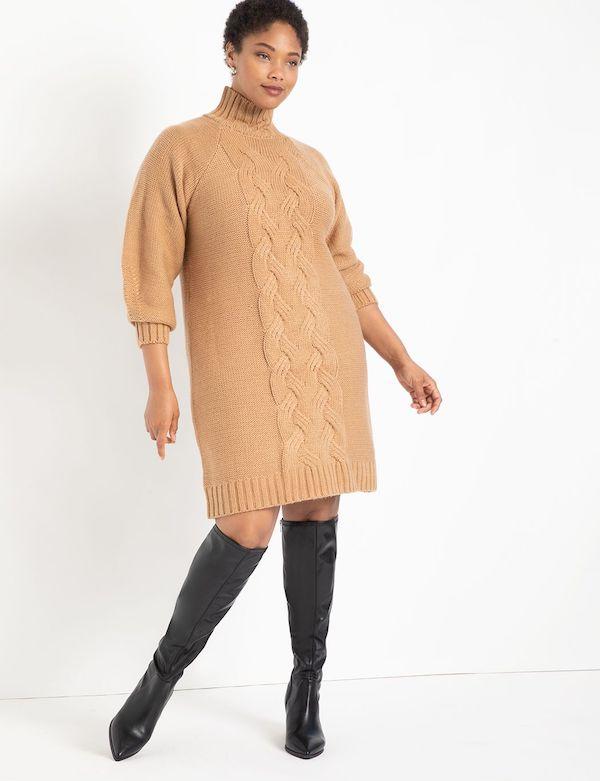 A model wearing a plus-size turtleneck dress in tan.