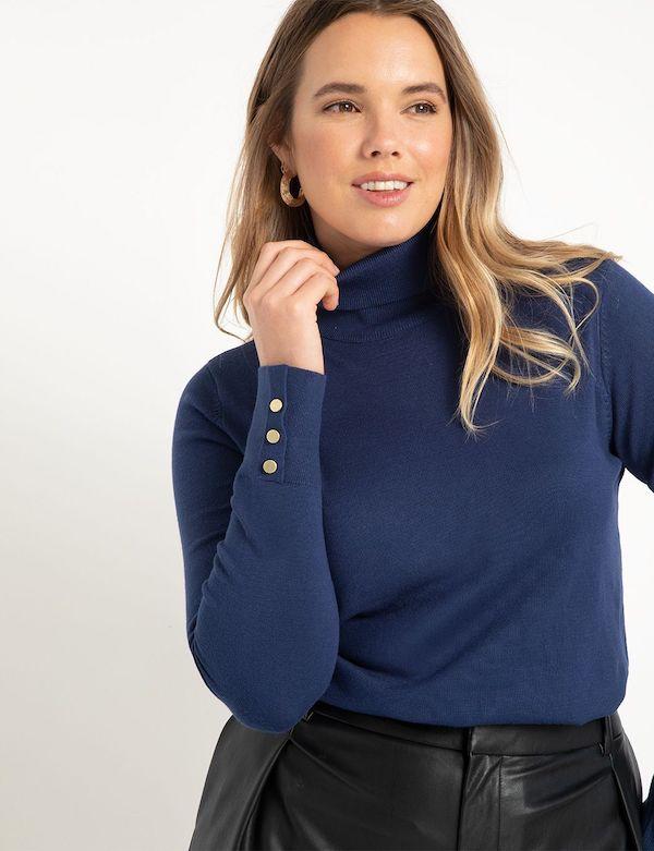 A model wearing a plus-size turtleneck sweater in navy blue.