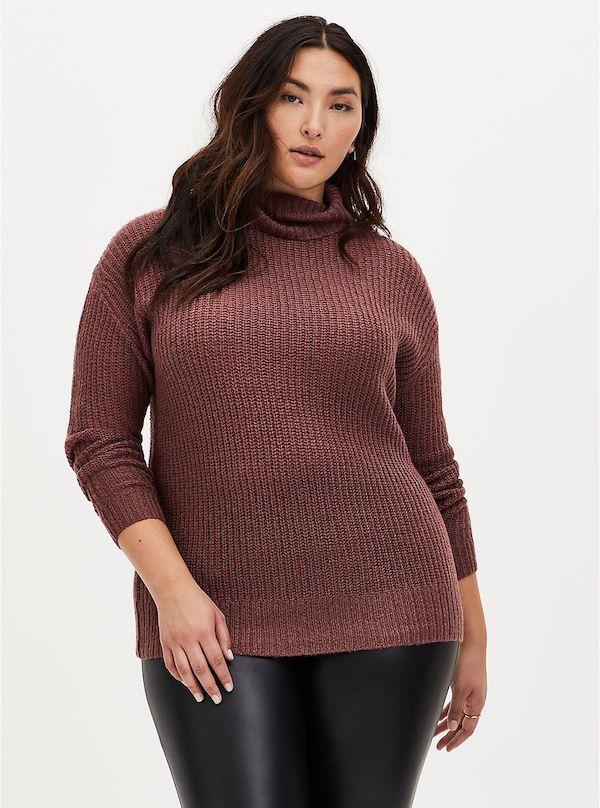 A model wearing a plus-size turtleneck sweater in brown.