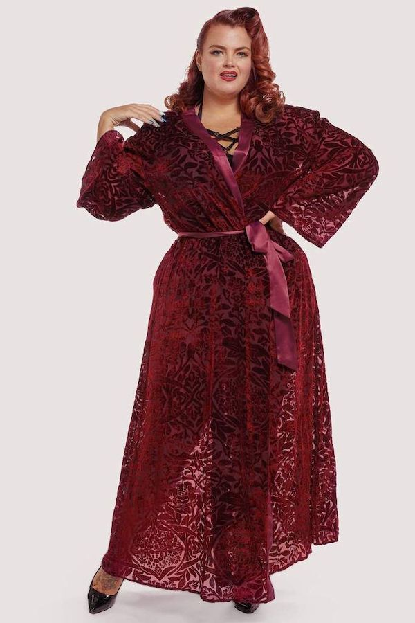 A model wearing plus-size burgundy velvet robe.