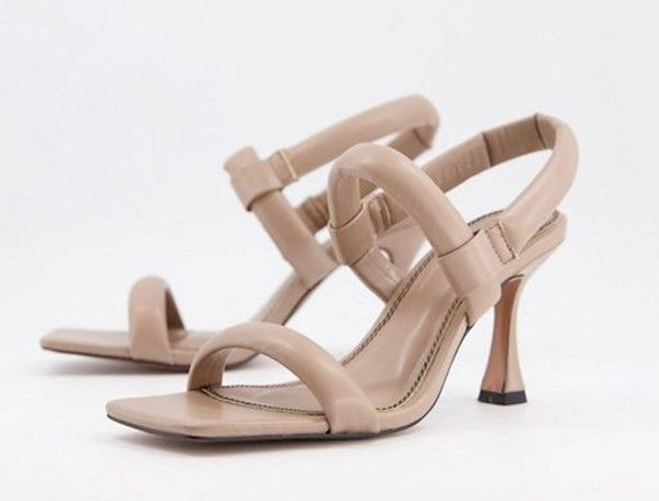 A pair of cream wide-fit heels.