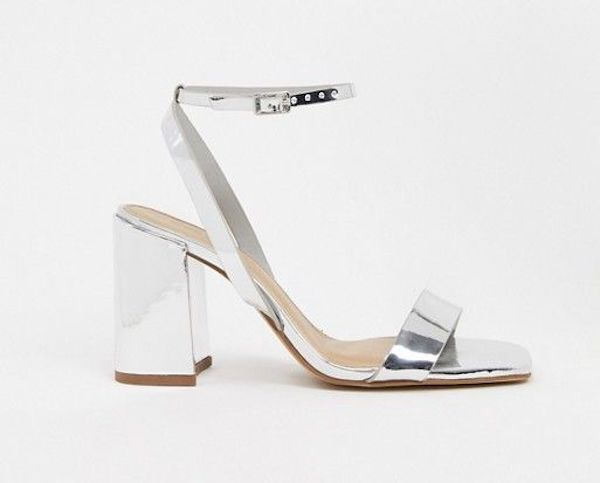 Silver and white wide-fit heels.