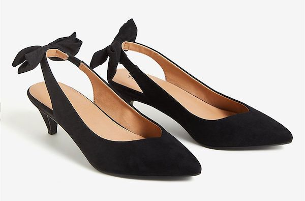 A pair of slingback wide-fit black heels.
