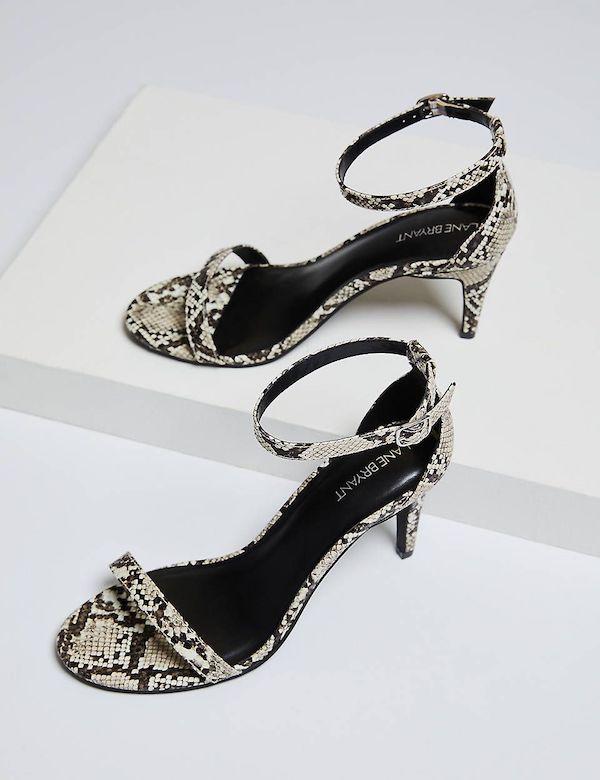 A pair of snake print heels.