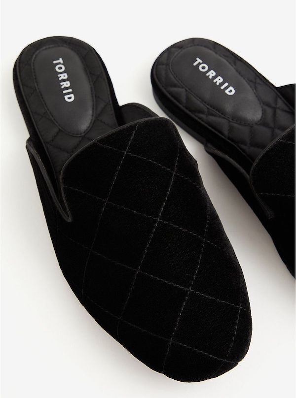 A pair of wide-fit mules in black.