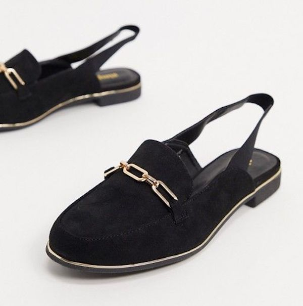 A pair of wide-fit mules in black with chain detail.