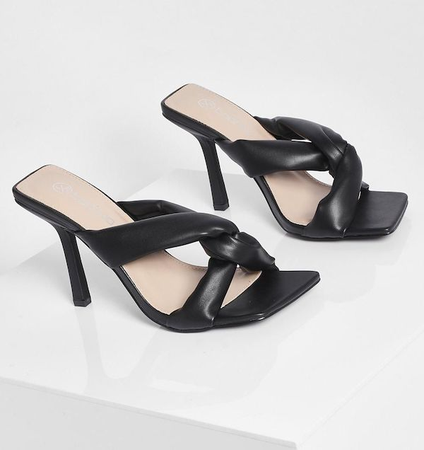 A pair of wide-fit mule heels in  black.