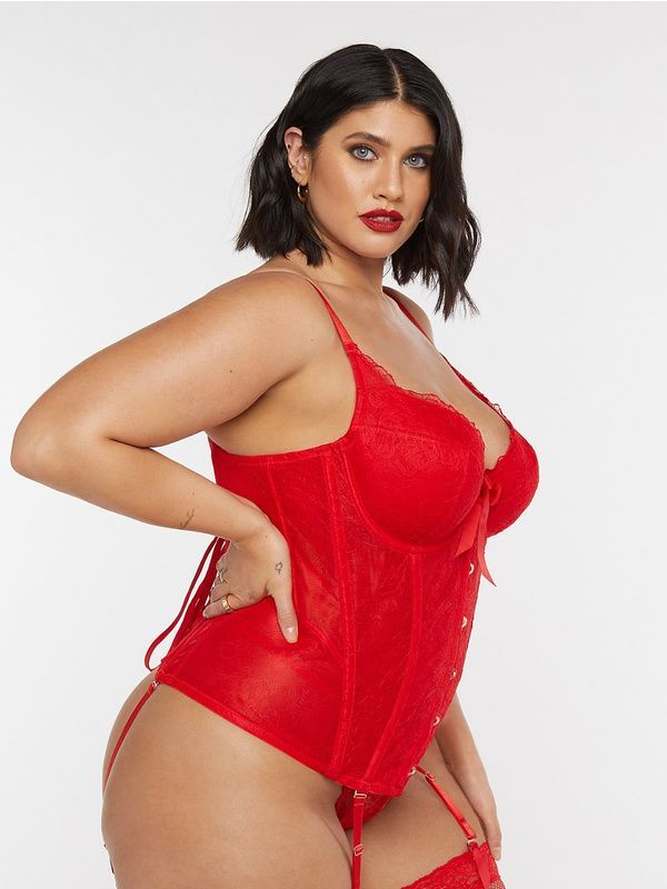 A model wearing a red plus-size corset.