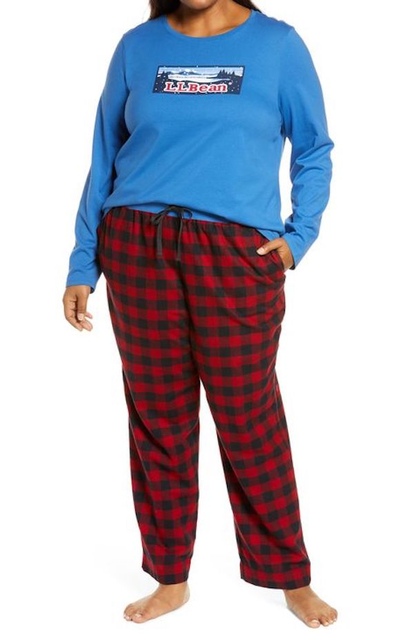 A model wearing plus-size flannel pajamas in dark red plaid.
