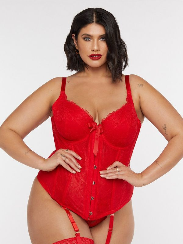 A model wearing a plus-size lace red corset.