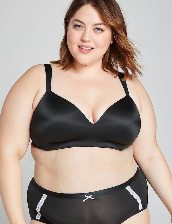 A model wearing a plus-size wire-free bra in black.