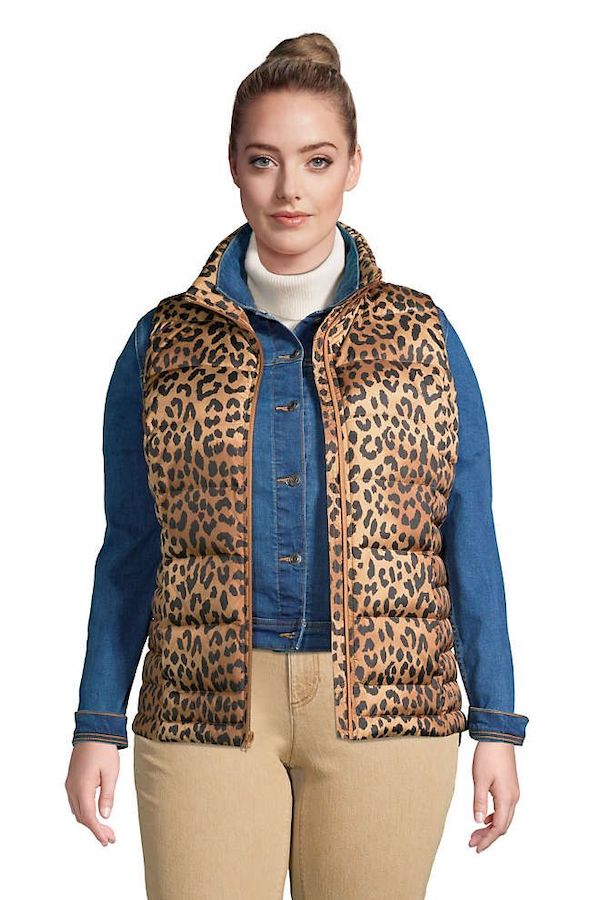 A model wearing a plus-size puffer vest in leopard print.