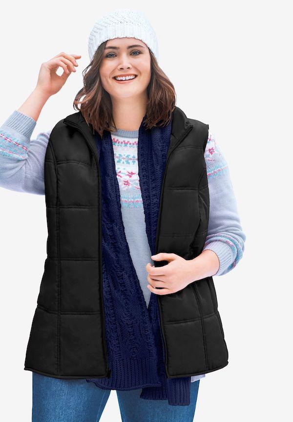 A model wearing a plus-size puffer vest in black.