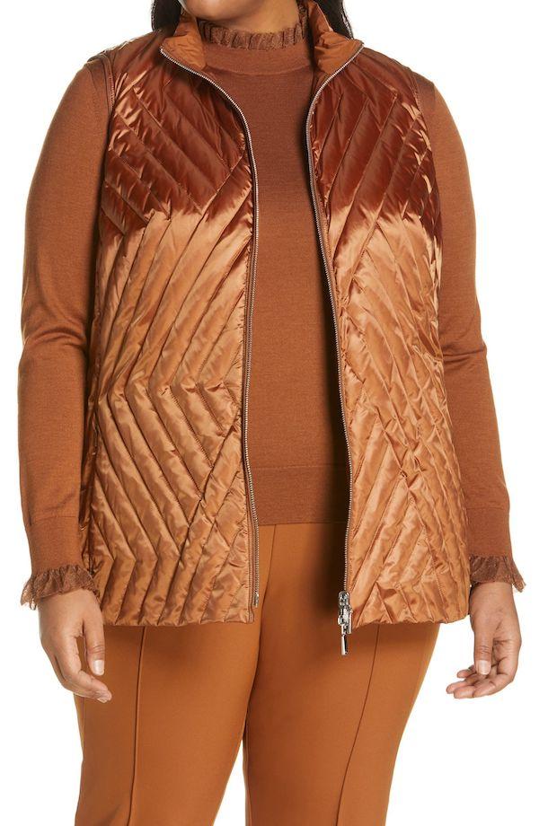A model wearing a plus-size puffer vest in bronze.