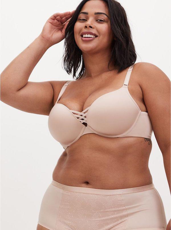 A model wearing a plus-size push-up bra in cream.