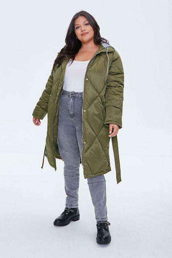 A model wearing a plus-size quilted jacket in green.