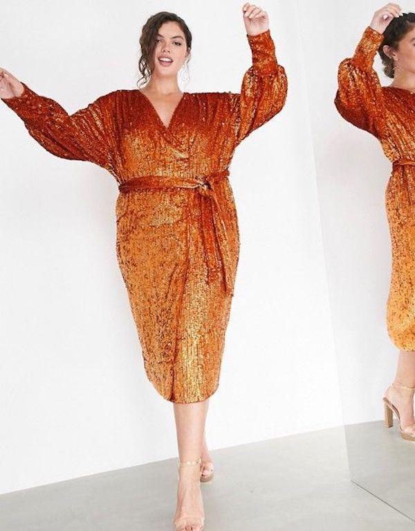 A model wearing a plus-size sexy winter dress in burnt orange.